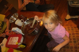 Cooking a cake in the Rogers House kitchen.